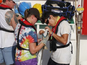 Night shift volunteers Page Vick and Claudia Friess work together to remove a hook.