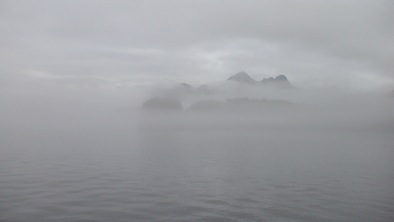 The RAINIER navigating through the area.  You can see through the fog there is a large rocky outcropping.