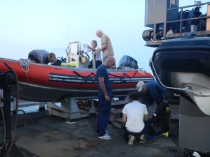 The divers prepare for the dives by programming the GPS, checking the gear, and loading the gear into the boat.