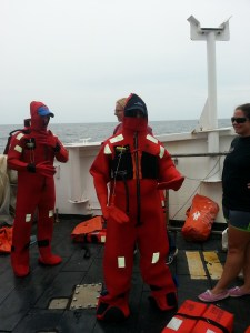 """This is the orange """"Gumby"""" suit that will keep you warm in the event of an abandon ship emergency. The safety drills occurred after departure to sea."""