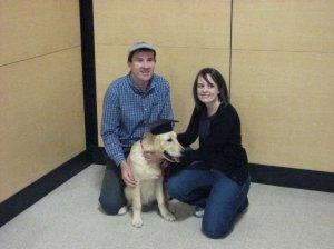 Janelle Harrier-Wilson with husband, Neil, and golden retriever, Devon, as a puppy.