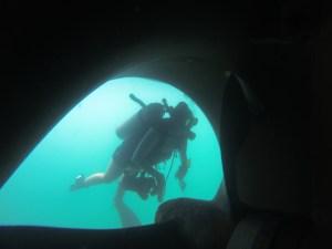 Sam dives under ship