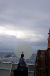 Jane launches the weather balloon.