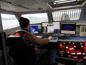 Hydrographic Assistant Survey Tech Chris Palmer keeping track of data.