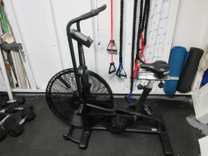 Weights, an exercise bike, resistance bands, and yoga mats.