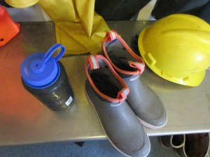 A water bottle, deck boots, and a hard hat