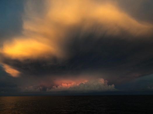 Darkening clouds over the water.