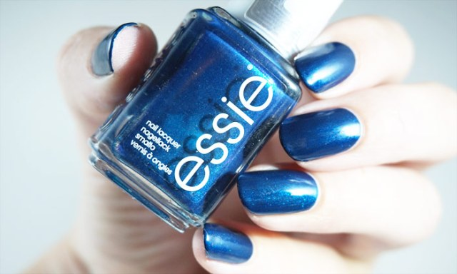 swatch of essie bell-bottom blues in strong artificial light