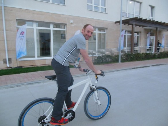 Brian Gregg Riding Bike in Sochi 2014 Olympic Coastal Village