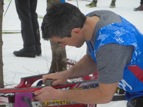 Zach Caldwell Preparing Skis for Olympic Skiathlon