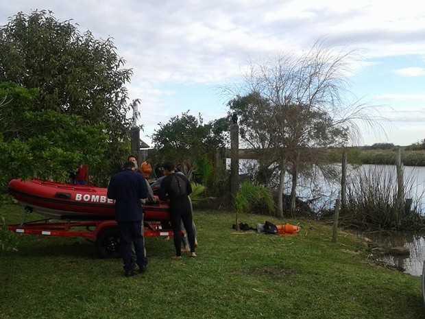 Corpo de menino foi localizado após buscas no Rio Tramandaí (Foto: Renato Dias/Correio do Imbé)
