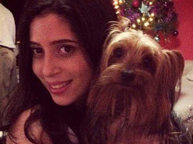 Gabriela Belota com o cachorro Rick; animal também foi morto na casa / Foto: Divulgação