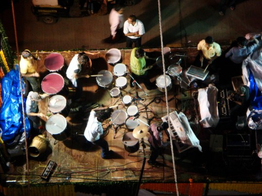 Massive moving stages playing loud music through the streets for Ganpati