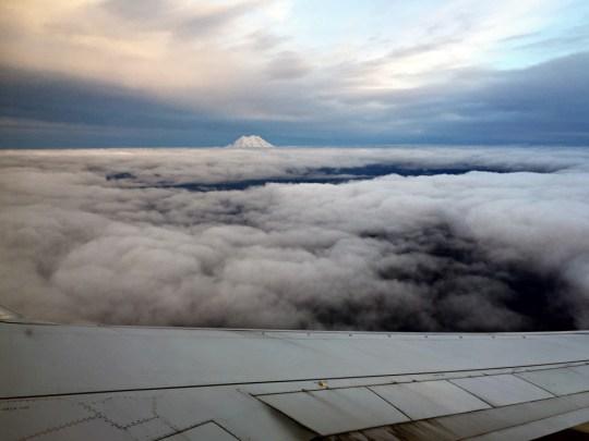 Family Weekend Winter Getaway in Seattle. Mt Rainier peeking through the clouds