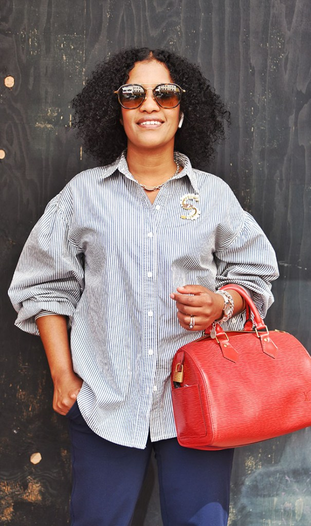 "Hawo Abdi of San Francisco caught our eye with her crisp puff-sleeved shirt, bold bag and vintage brooch. ""I like my look comfortable and not too tight. An everyday style — and classy looking!' Top: Levi's; Pants: Lululemon; Bag: Louis Vuitton"