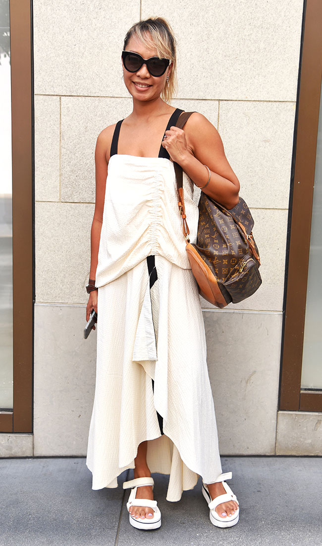 """Suzy Mora from San Francisco shops high-low, mixing high-fashion classics with fast-fashion trends.  """"I'm inspired by the unusual — different shapes  and silhouettes."""" Dress: Asos; Sunglasses: Fendi; Sandals: Tevas;  Backpack: Louis Vuitton"""