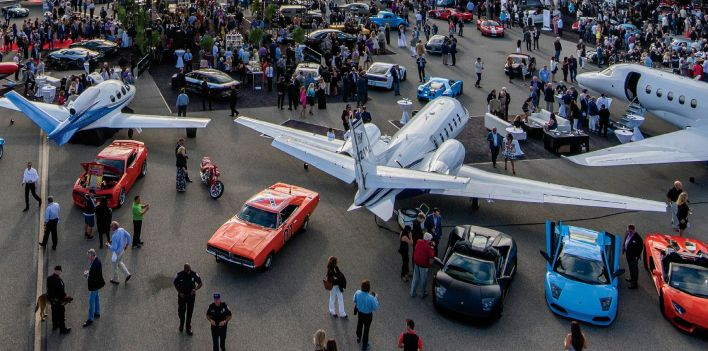 McCall Long Shot (McCall's) Monterey Jet Center provides McCall's Motorworks Revival with an eclectic mix of cars and airplanes and food and wine.