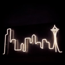 Seattle Skyline, 2013. Neon on stained birch, approx. 1ft by 3 ft. Commission for Chris McIalwain. Photo by Lia Hall