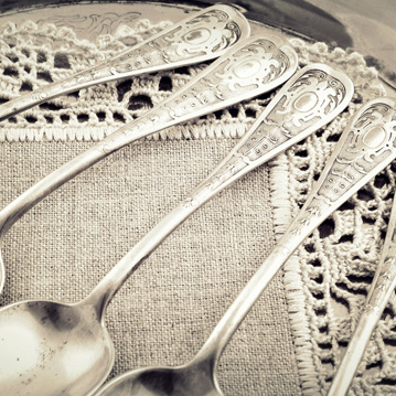 Beautiful antique silverware on lacy napkin