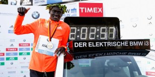 BERLIN, GERMANY - SEPTEMBER 28: Dennis Kimetto of Kenya poses with his new world record time after winning the 41th BMW Berlin Marathon on September 28, 2014 in Berlin, Germany. (Photo by Boris Streubel/Bongarts/Getty Images)