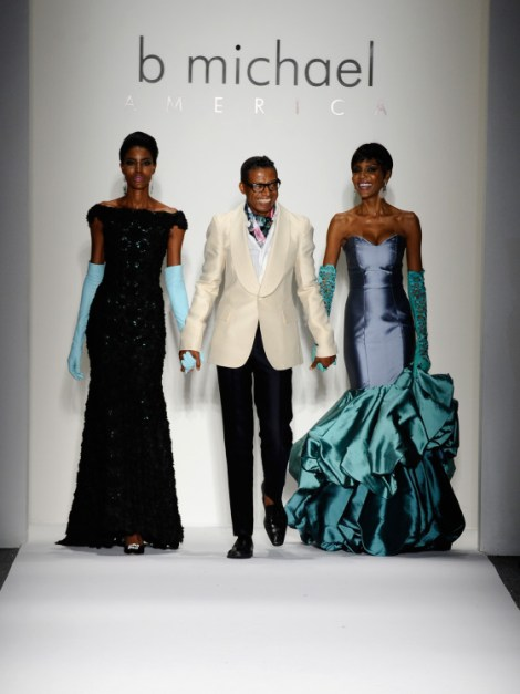 B Michael walks out with models Maya Haile (L) and Lu Sierra at the end of his fashion show. (Photo by Fernanda Calfat/Getty Images for Mercedes-Benz Fashion Week Spring 2014)