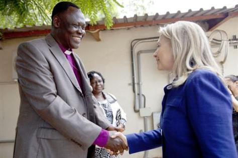 Bishop Elias Taban greets Clinton in Juba