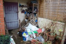 after the storm, there used to be some smart trellis here making a tidy storage area!