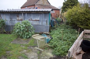 back of the shed, where Charles mixes the salad