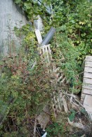 The bottom of the garden when I have one heap and store much of the timber from the damaged sheds