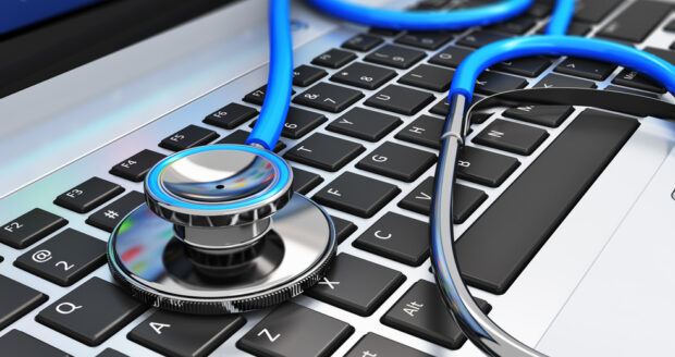 Stethoscope on laptop keyboard