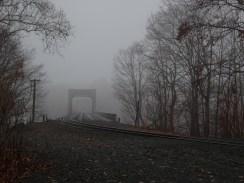 Foggy railroad bridge