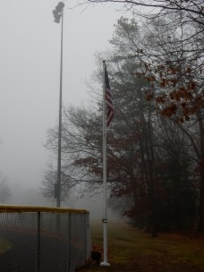 I really like the way the flag behind center field sands out in the fog.