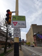 This sign is in the Strip District in Pittsburgh. Pittsburgh is said to be one of the most bike-friendly cities in the states.