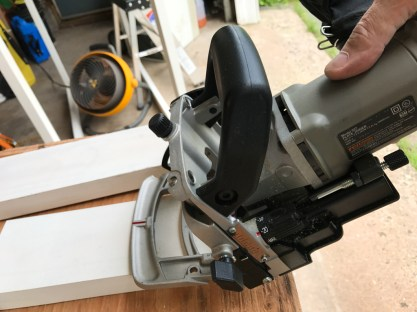 The joints are held together with glue, screws and biscuits. Biscuits are little oval plates that fit into slots that are cut by this little machine.