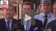 ABC News Qld: Police stand with ministers to trumpet High Court dismissal of VLAD challenge.