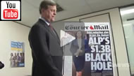 9 News Brisbane: Qld Treasurer Tim Nicholls poses with an enlarged Courier Mail front page for the media.