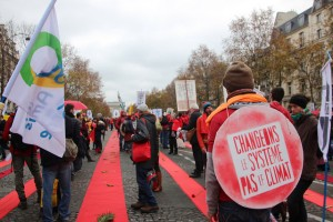 Redlines from the Arc de Triumphe for climate justice