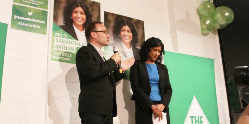 Adam Bandt MP introducing Samantha Ratnam. Photo: John Englart