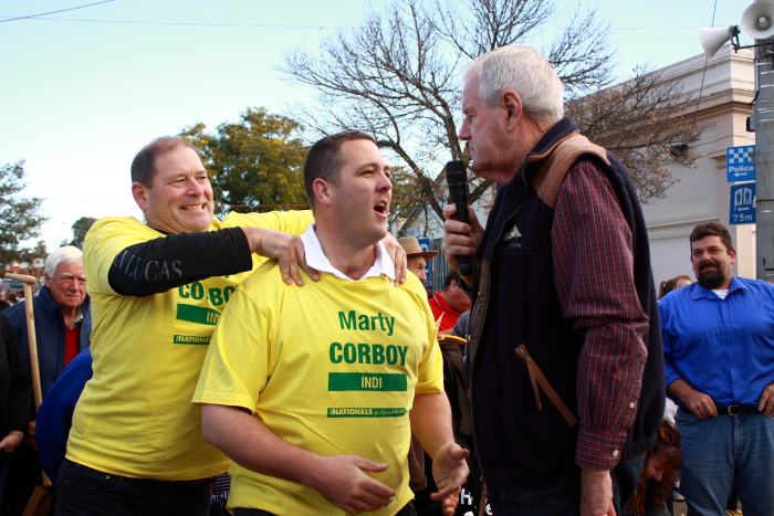 Tim McCurdy, Victorian MLA for Ovens Valley and Jasper give Corboy some last minute coaching for the grape stomp. Photo: @Jansant