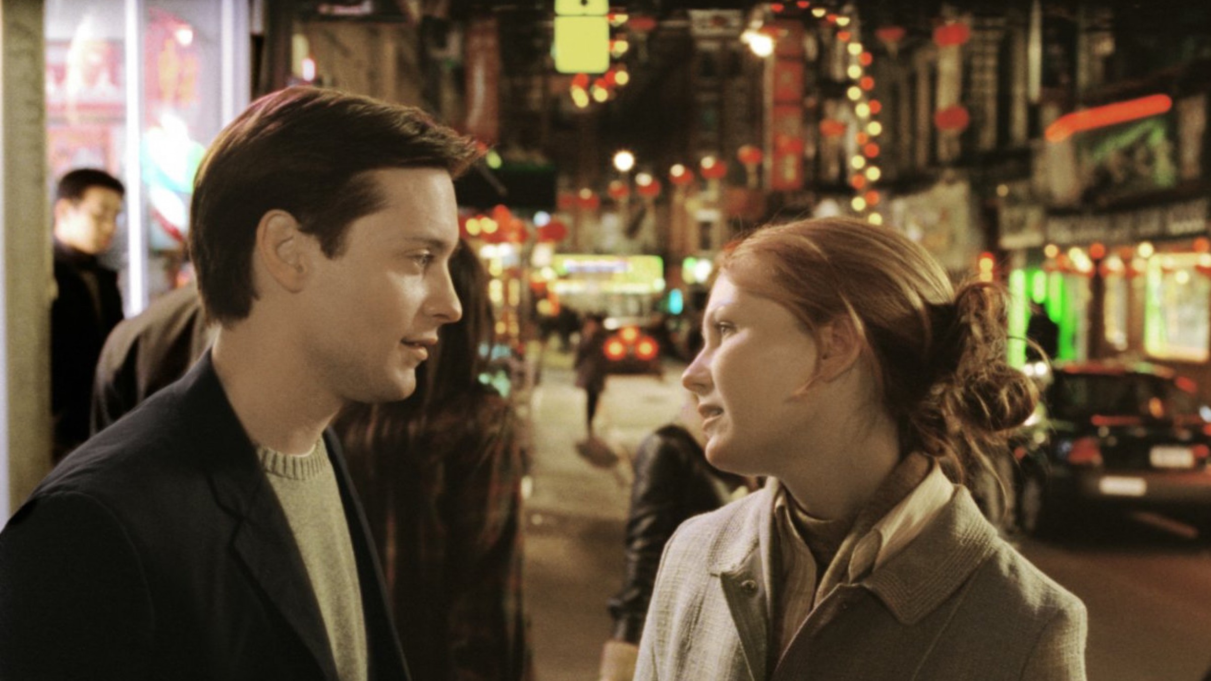 Peter Parker talking Mary Jane Watson on the streets of New York City in Spider-Man 2.