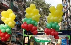 The yellow green and red stripes of Burma/Myanmar flag in balloons