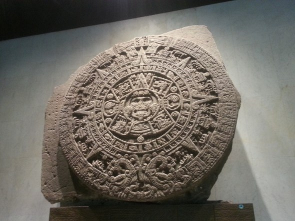 Stone disk with carvings