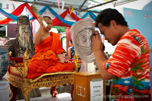 The monks will bless them by sprinkling holy water on them.