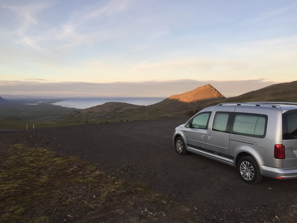 VW Caddy Camper parked overlooking a valley and water on the Snaefellsnes Peninsula