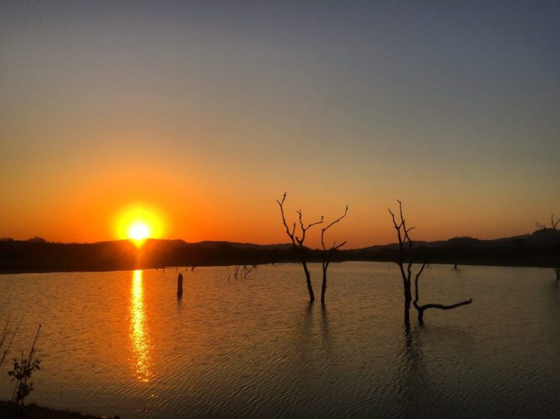 Sunset at the earthen dam, Wolhuter Wilderness Trail, Kruger National Park, South Africa