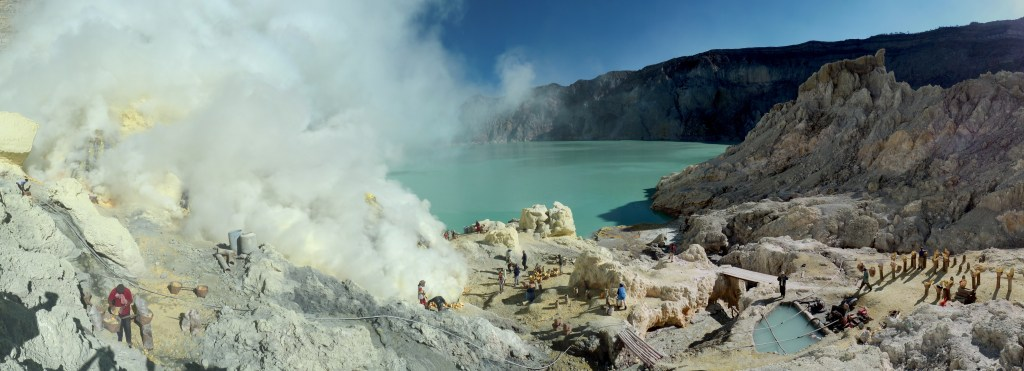 Sulphur mining on the shores of Kawah Ijen's turquoise acid lake