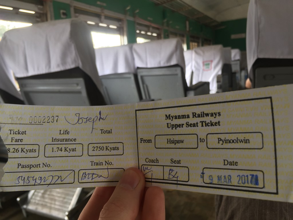 Holding my handwritten ticket for crossing Goteik Viaduct from Hsipaw to Pyin Oo Lwin