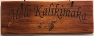 "'Mele Kalikimaka' Large Hanging Koa Plaque 4""x 11"" (representative) by Honolulu Woodworking Designs $36"