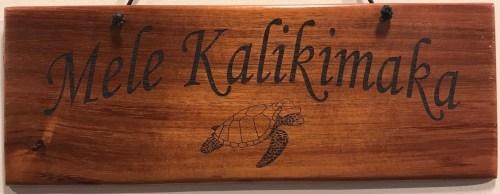 "'Mele Kalikimaka' Large Hanging Koa Plaque 4""x 11"" (representative) by Honolulu Woodworking Designs $36"