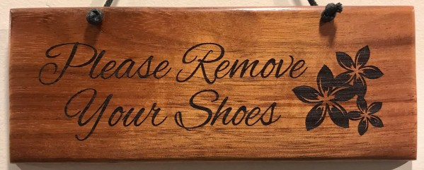 """'Please Remove Your Shoes' Small Hanging Koa Plaque 2.75""""x 7"""" (representative) by Honolulu Woodworking Designs $24"""
